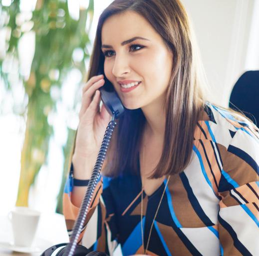 Business woman talking on landline